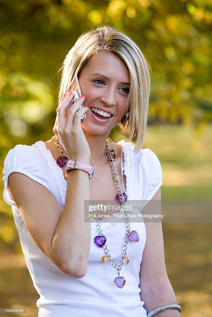 Teenage girl talking on cell phone : Stock Photo