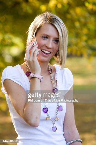 Teenage girl talking on cell phone : Stock Photo
