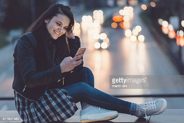 Teenage girl text messaging on smartphone