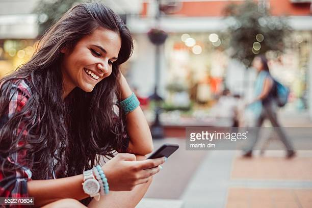Teenage girl texting for Uber