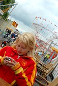 Teenage girl texting from mobile at fairground