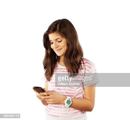 Teenage girl texting on smartphone