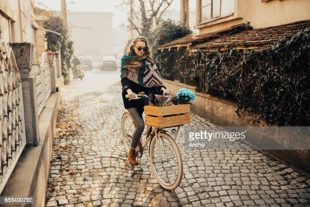 Teenage girl took the oportunity to ride her bike in the cold autumn