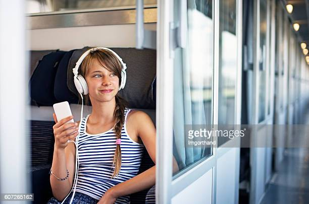 Teenage girl travelling on train in Italy