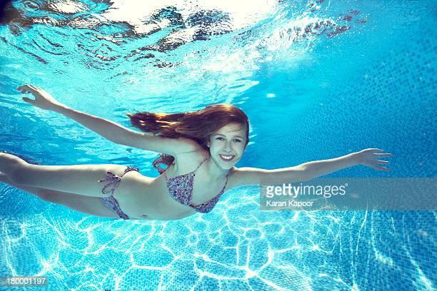 Teenage girl underwater