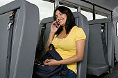 Teenage Girl Using Cell Phone on Bus