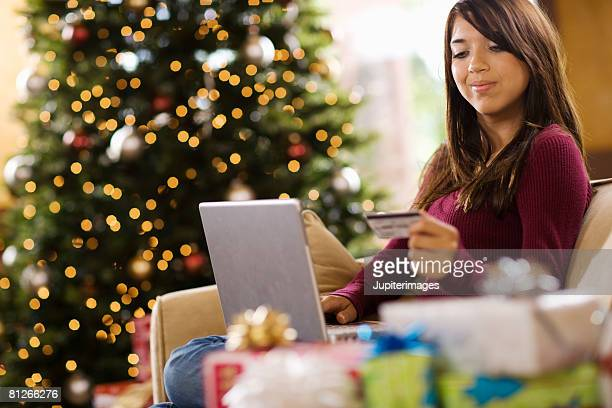 Teenage girl using laptop computer at Christmas
