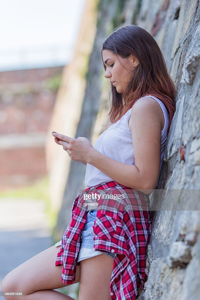 Teenage girl using phone : Stock Photo