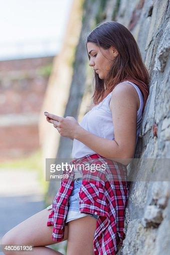 Teenage girl using phone : Stock Photo