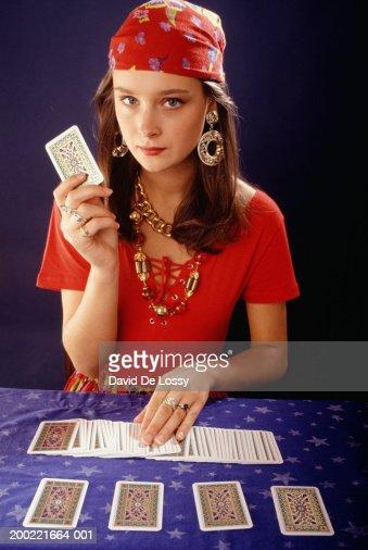 Teenage girl (16-17) using tarot cards, portrait