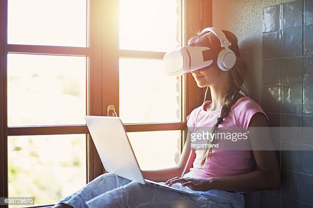 Teenage girl using Virtual Reality headset