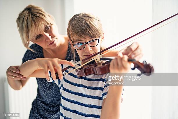 Teenage girl violin lesson
