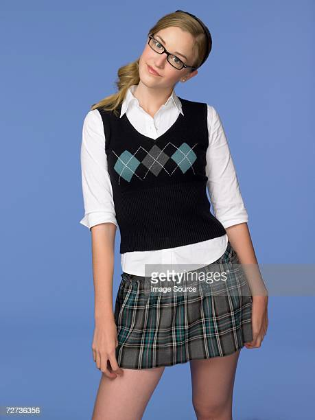 Teenage girl wearing a school uniform