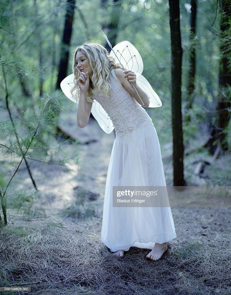 Teenage girl (14-16) wearing fairy costume : Stock Photo