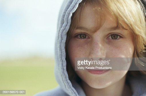 Teenage girl (13-15) wearing hooded sweatshirt, close-up, portrait : Stock Photo