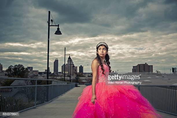 Teenage girl wearing long dress,looking away