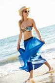 Teenage Girl Wearing Sarong On Beach Holiday