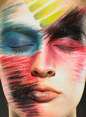 Teenage girl (15-17) wearing stage makeup, eyes closed, close-up