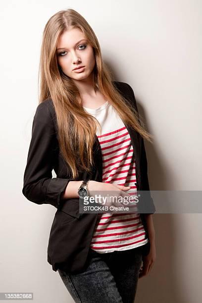 Teenage girl wearing striped top and blazer