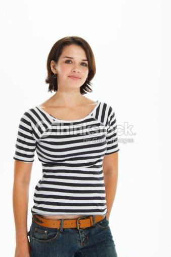 Teenage Girl Wearing Striped Tshirt And Denim Jeans Portrait Stock Photo | Thinkstock