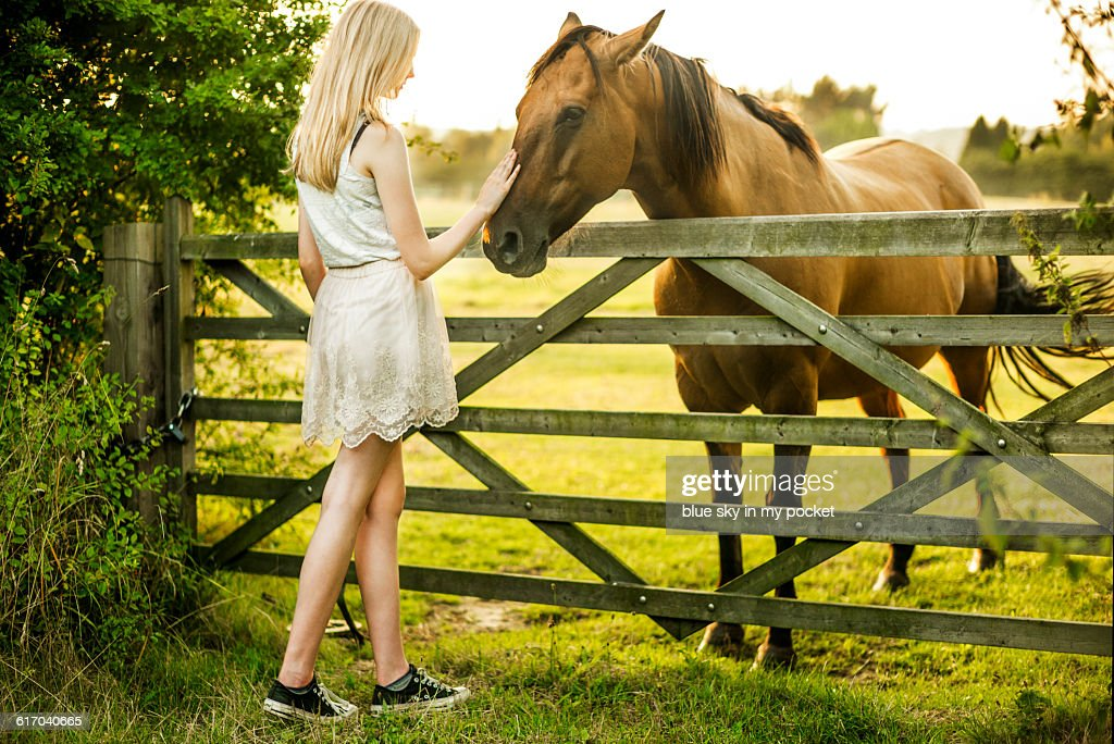 A teenage girl with a horse. : Stock Photo