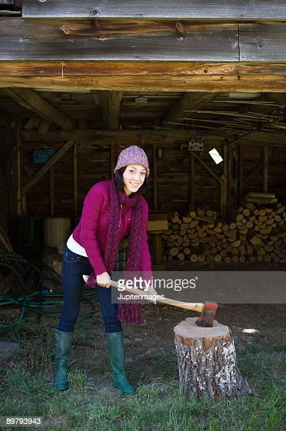 Teenage girl with axe