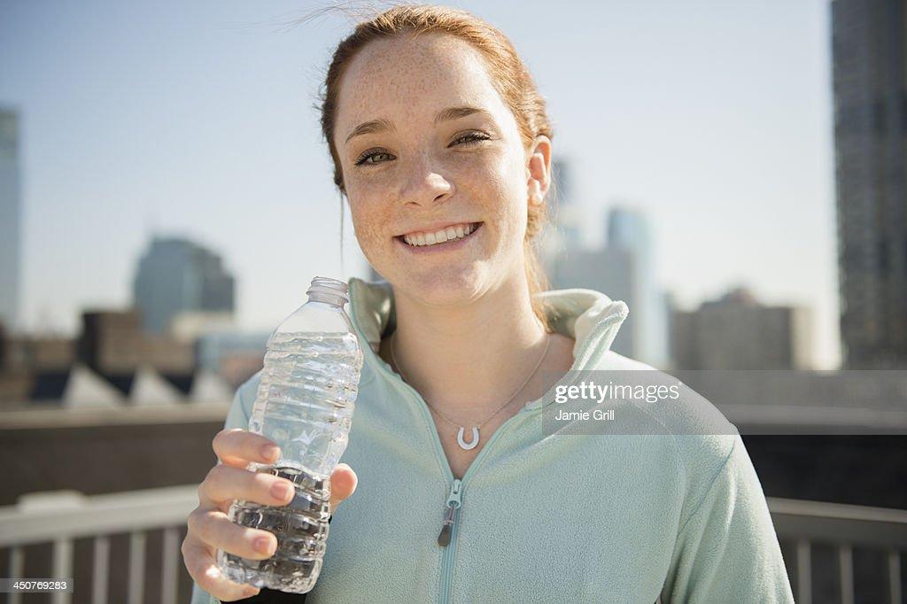 Teenage girl (14-15) with bottle of water : Stock Photo