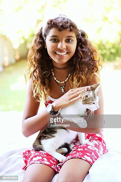 Teenage girl with cat