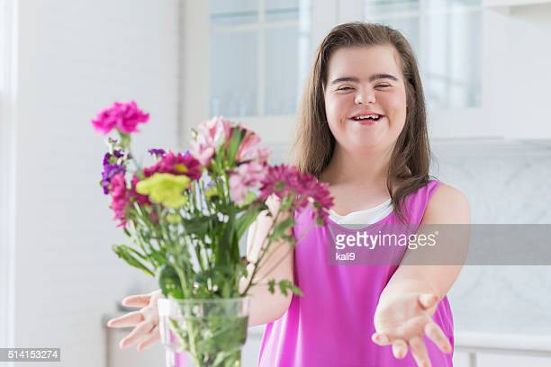 Teenage girl with down syndrome arranging flowers