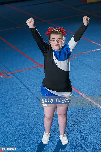 Teenage girl with down syndrome cheerleading