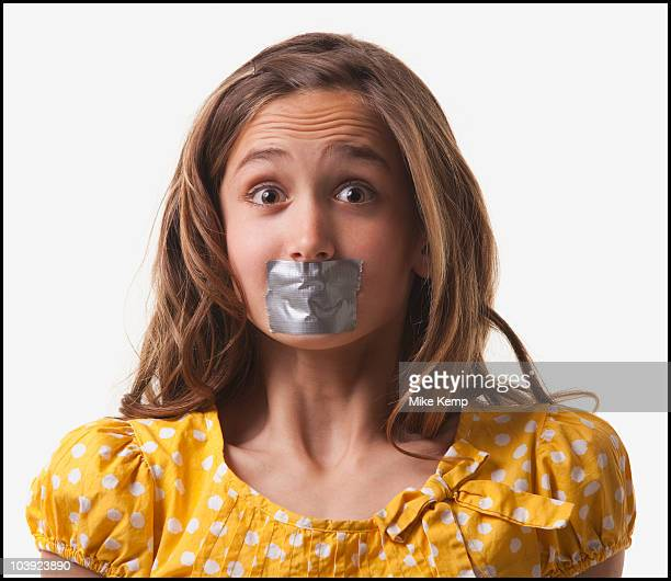 Teenage girl with duct tape on her mouth