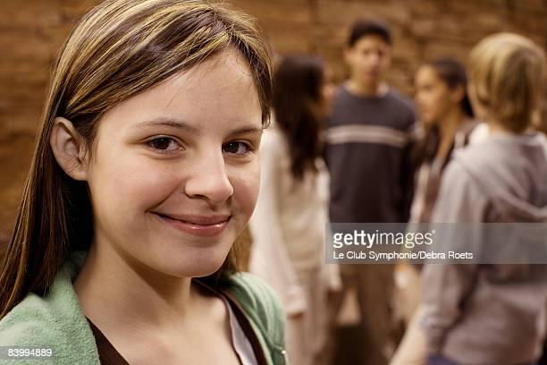 teenage girl with friends behind