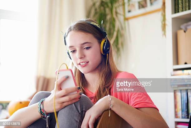 teenage girl with headphones and mobile phone