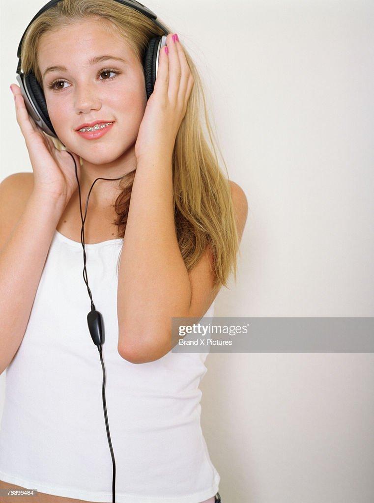teenage girl with headphones stock photo getty images