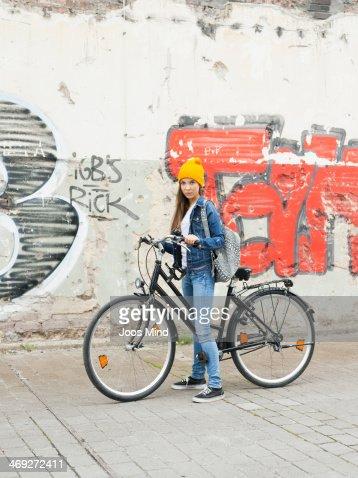 Teenage girl with her bike, portrait : Stock Photo