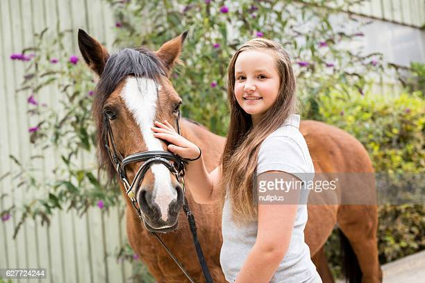 Teenage Girl With Her Pony
