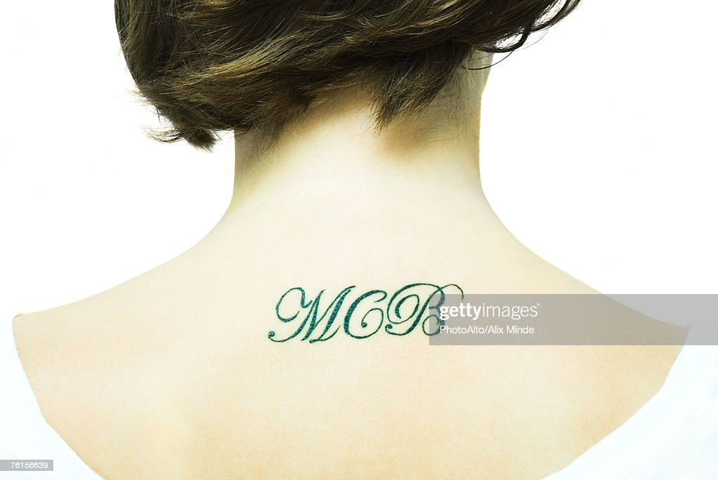 'Teenage girl with initial's tattooed onto upper back, close-up' : Stock Photo