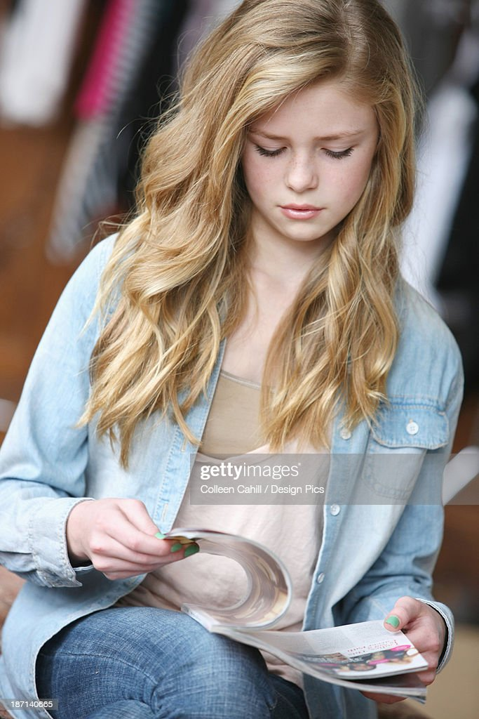 Teenage Girl With Long Blond Hair And Blue Eyes Reading A ...