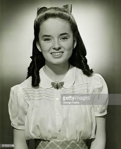 Teenage girl (14-15) with long hair, (B&W), portrait