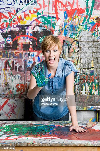A teenage girl with paint on her hand