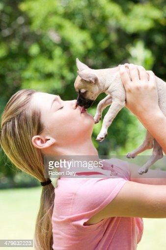 Teenage girl with puppy dog : Stock Photo