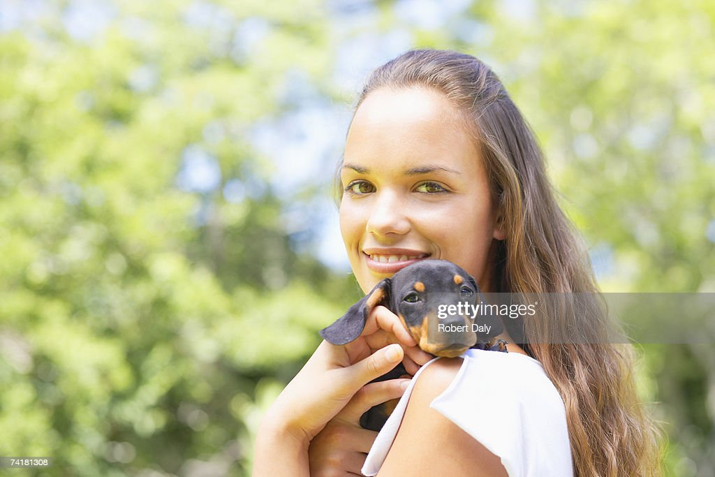 Teenage girl with puppy dog : Stock Photo