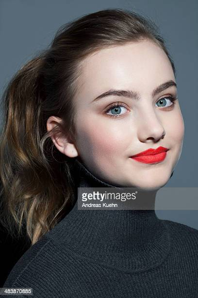 Teenage girl with red lip stick, portrait.