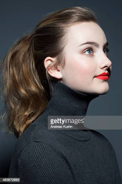 Teenage girl with red lip stick, profile.