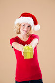 Teenage girl with santa's hat and present