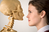Teenage girl with skeleton
