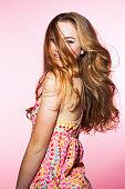 Teenage girl with wind blown hair, portrait.