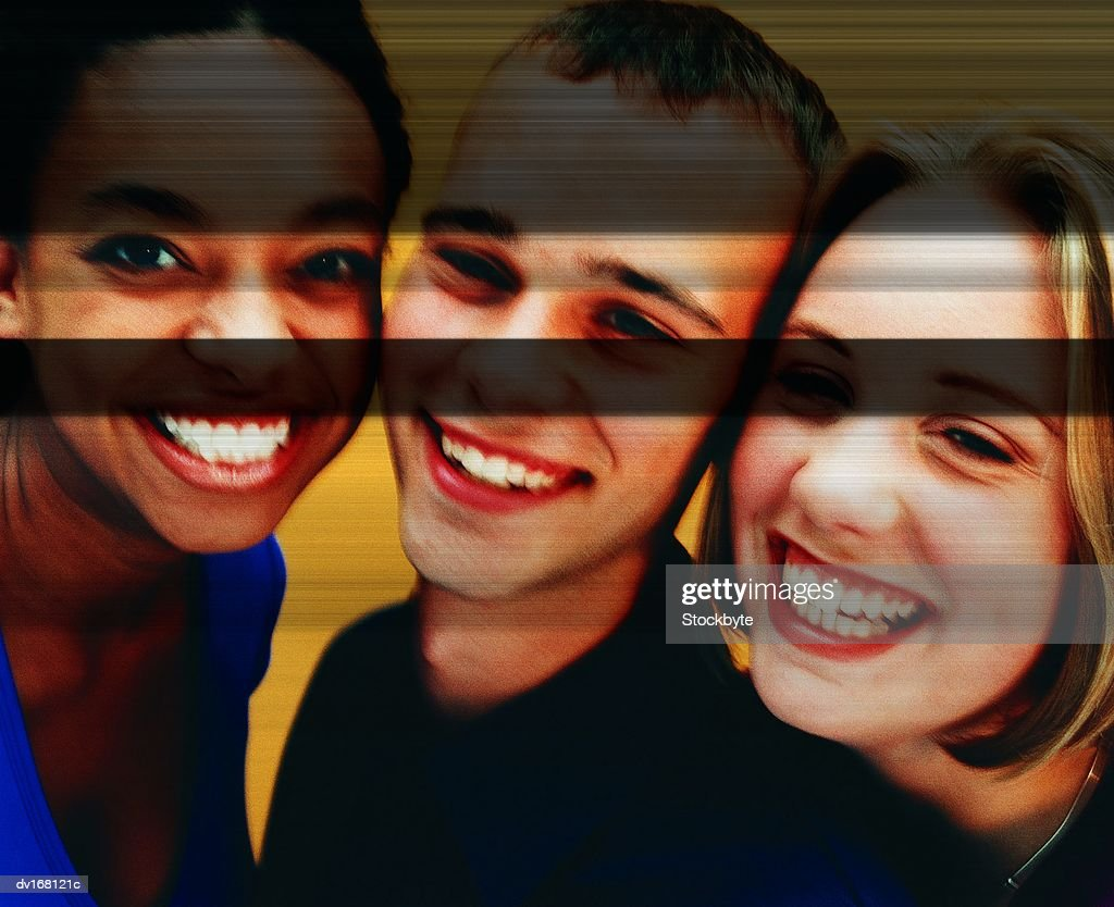 Teenage girls and boy smiling together : Stock Photo