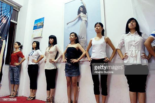 Teenage girls attending modeling class in one of a few modeling schools in Vietnam Modeling is becoming more popular in the country as the fashion...