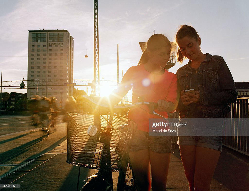 Teenage girls by sunset